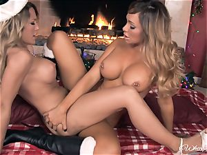 destiny Dixon and Capri Cavalli joy in front of the fire