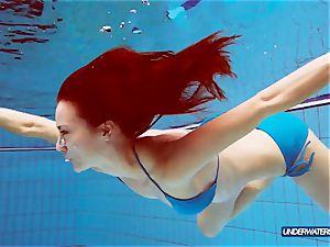 sandy-haired in blue bikini displaying her bod