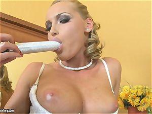 Kathia Nobili platinum-blonde dildoing her tit
