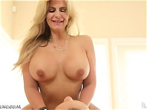 spunky blondie Phoenix Marie with giant knockers tempts youthfull man