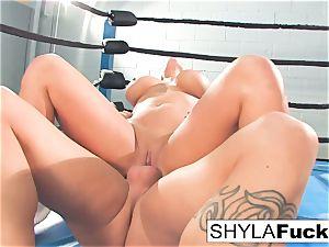 Shyla gets some lessons on wrestling instructing